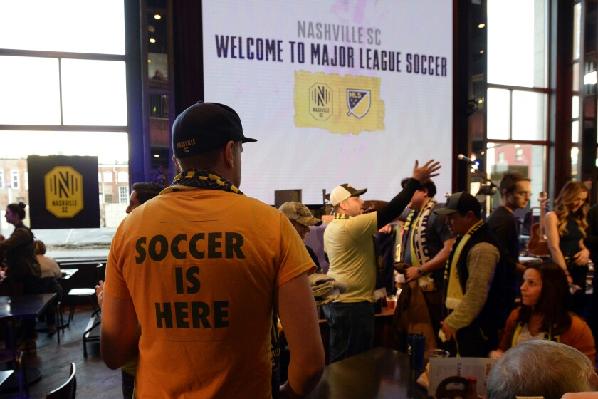 A Nashville SC fan looks for a seat before the start of the MLS expansion draft Nov. 19.