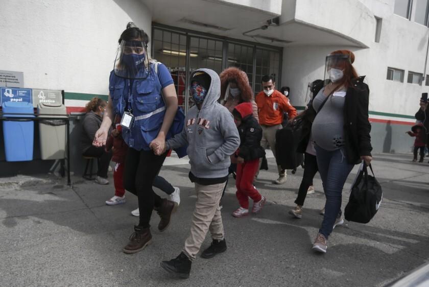 A migrant family crosses the border Feb. 26 from Ciudad Juarez, Mexico, into El Paso.