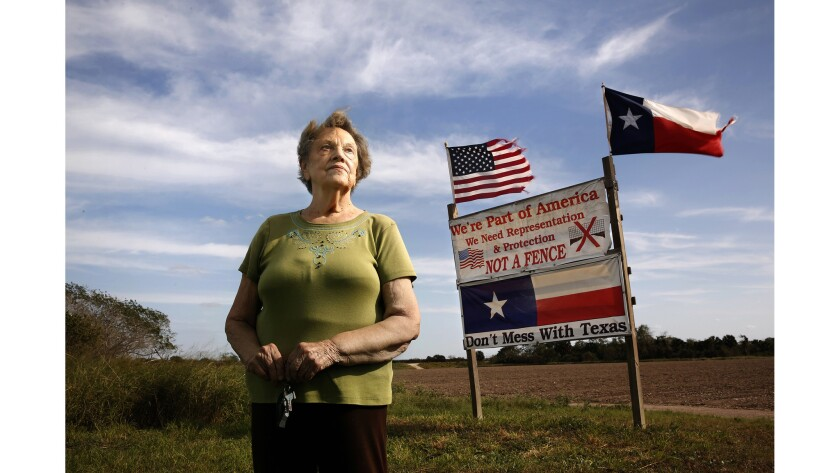 Pamela Taylor, 88, lives on the border where she and her children have put up a sign to say they don't want a fence.