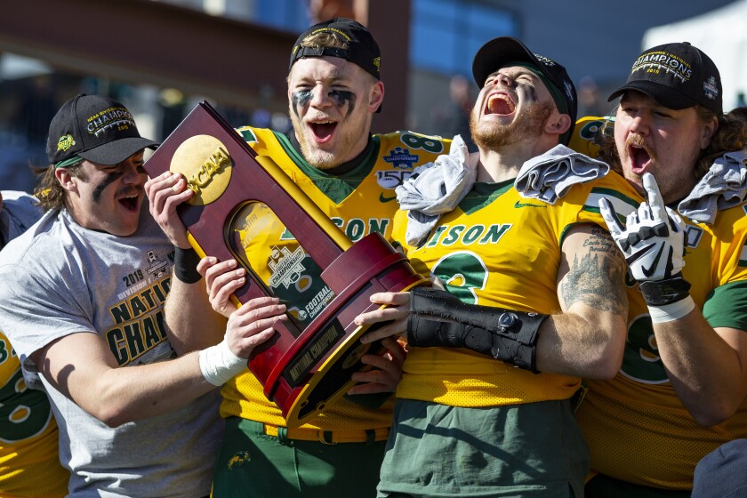 North Dakota State football players celebrate beating James Madison 28-20 in the FCS championship game Jan. 11, 2020.
