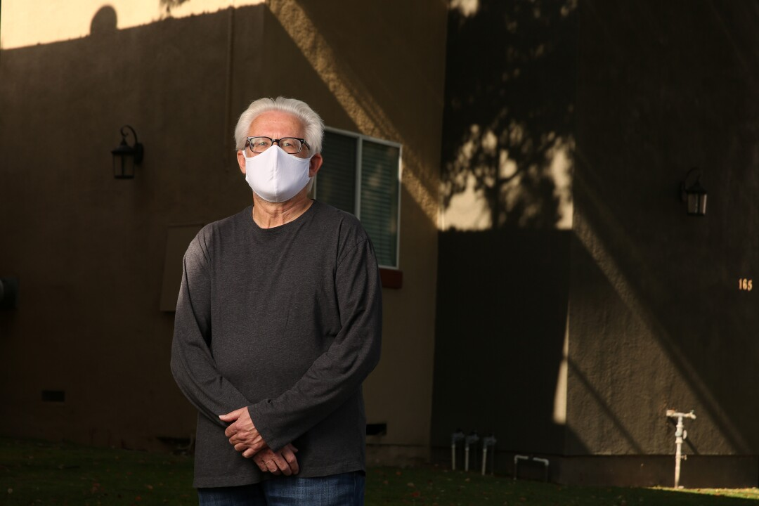 CASA volunteer Dave Stein poses for a portrait while wearing a mask
