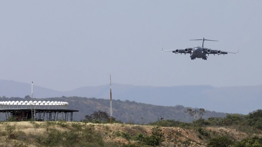An United States Air Force C-17 cargo plane loaded with humanitarian aid arrives at Camilo Daza airp