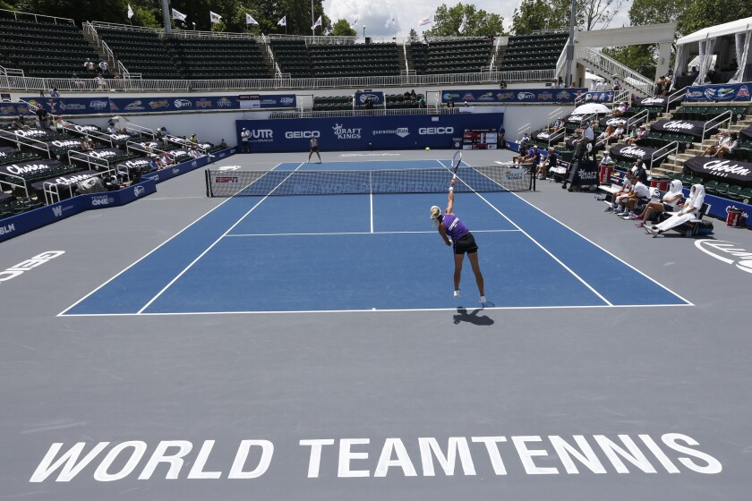 Springfield Laser tennis player Olga Govortsova delivers a serve during the World TeamTennis tournament at The Greenbrier resort Sunday July 12, 2020, in White Sulphur Springs, W.Va. (AP Photo/Steve Helber)