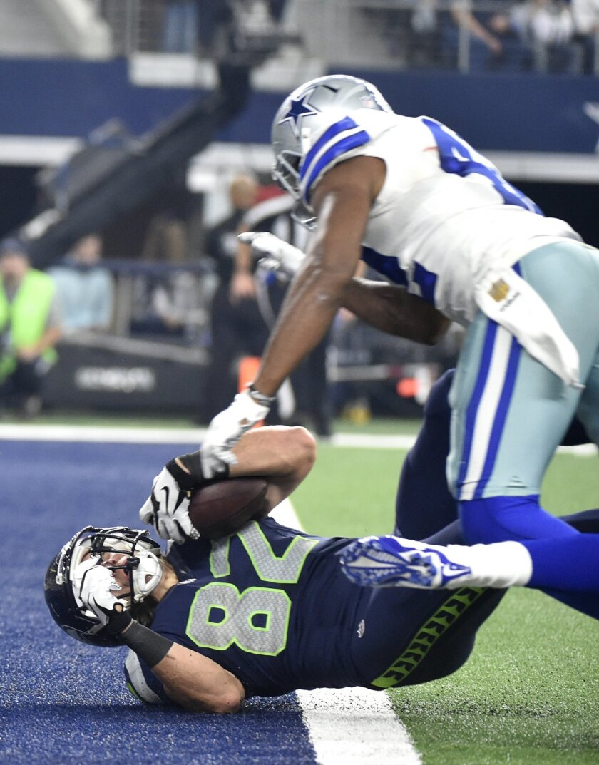 Seattle Seahawks tight end Luke Willson (82) falls into the end zone to score a touchdown after getting by Dallas Cowboys strong safety Barry Church, right, in the first half of an NFL football game Sunday, Nov. 1, 2015, in Arlington, Texas. (AP Photo/Michael Ainsworth)