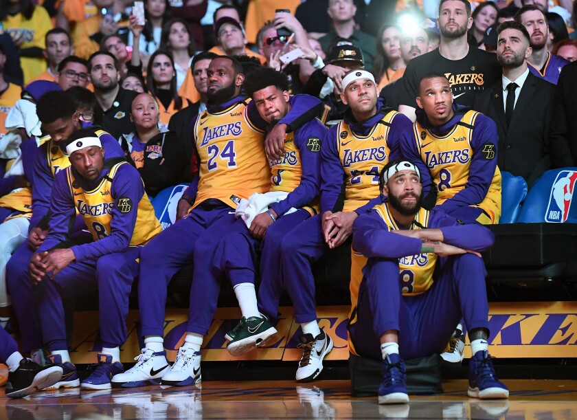 The Lakers hold each other close during a performance by Usher on a night the organization honored the life of Kobe Bryant at Staples Center.