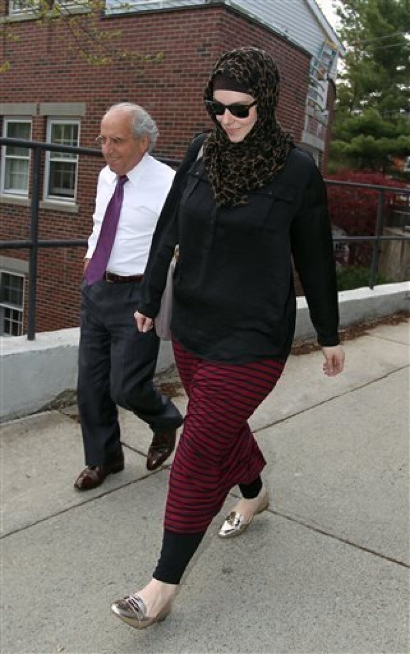 FILE - In this April 29, 2013 file photo, Katherine Russell, wife of Boston Marathon bomber suspect Tamerlan Tsarnaev, right, leaves the law office of DeLuca and Weizenbaum with Amato DeLuca, in Providence, R.I. Relatives of Tsarnaev, the older of the brothers suspected in the Boston Marathon bombi