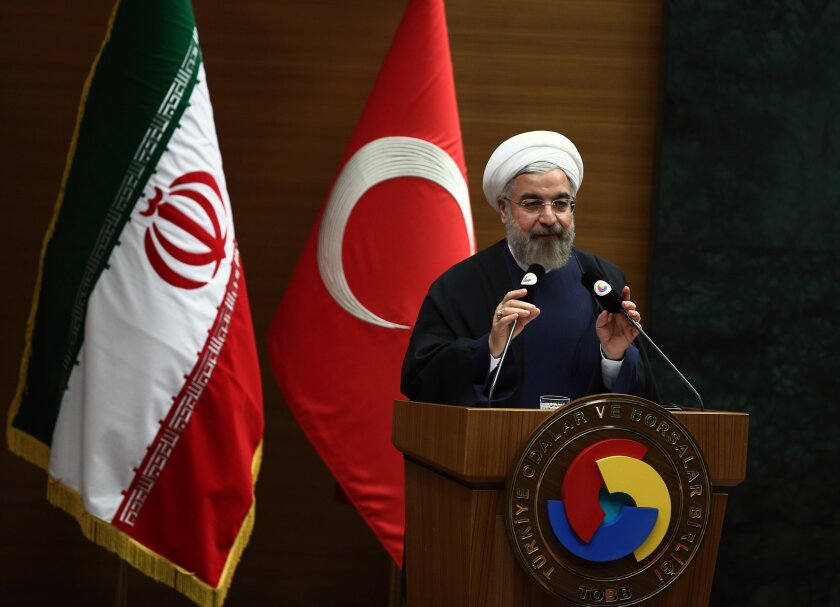 Iranian President Hassan Rouhani addresses a Turkish-Iranian business forum in Ankara, Turkey, Tuesday, June 10, 2014. Rouhani is in Turkey for a two-day state visit. (AP Photo)