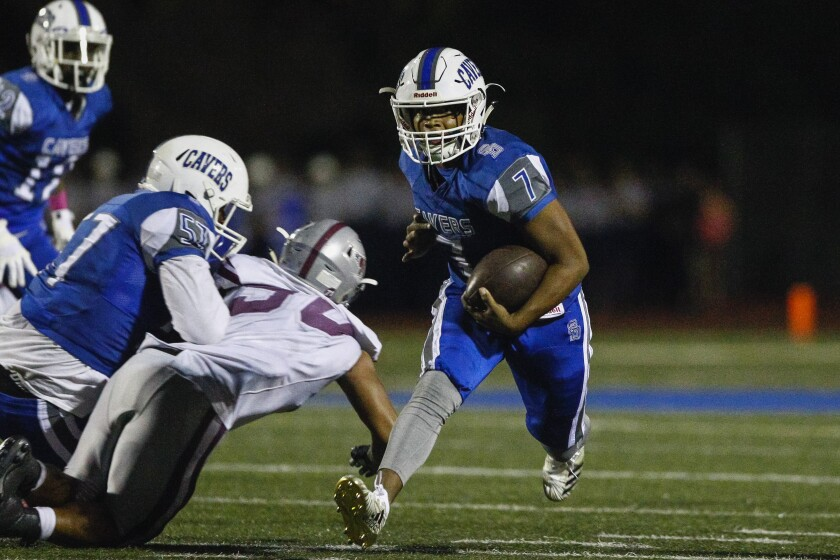 San Diego running back Mo Jackson (7) rushes during the second quarter against Kearny.