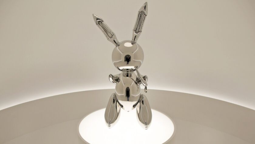 """Rabbit"" by Jeff Koons is displayed during a media preview at Christie's in New York, Friday, May 3,"