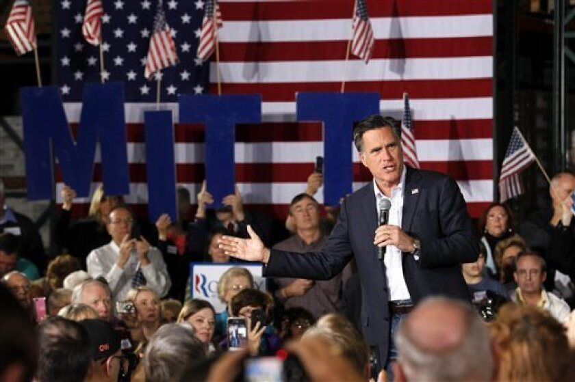 Republican presidential candidate, former Massachusetts Gov. Mitt Romney, speaks at a campaign rally in Las Vegas, Wednesday, Feb. 1, 2012. (AP Photo/Gerald Herbert)