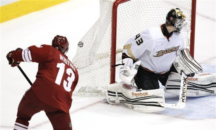 Phoenix Coyotes' Ray Whitney (13) scores a goal against Anaheim Ducks' Jeff Deslauriers (43) during the second period in an NHL hockey game, Saturday, March 31, 2012, in Glendale, Ariz. (AP Photo/Ross D. Franklin)
