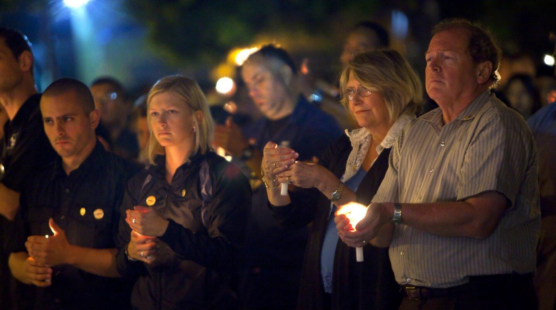 Candlelight vigil for slain officer