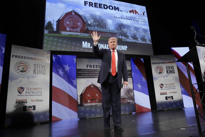 Donald Trump waves after speaking at the Freedom Summit Saturday in Iowa.