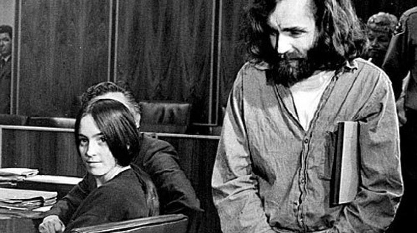 Susan Atkins looks back as Charles Manson arrives in court in 1970. She was convicted on seven counts of first-degree murder in the Tate-LaBianca killings, including the death of pregnant actress Sharon Tate.