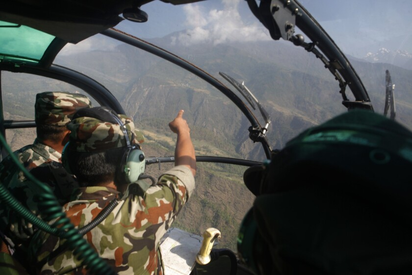 Nepalese soldiers search for a missing U.S. Marine helicopter in the Dolakha district on May 14.