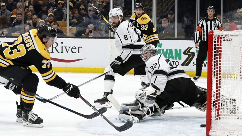 Boston Bruins' Charlie McAvoy (73) scores past Kings goaltender Jonathan Quick during the second period.