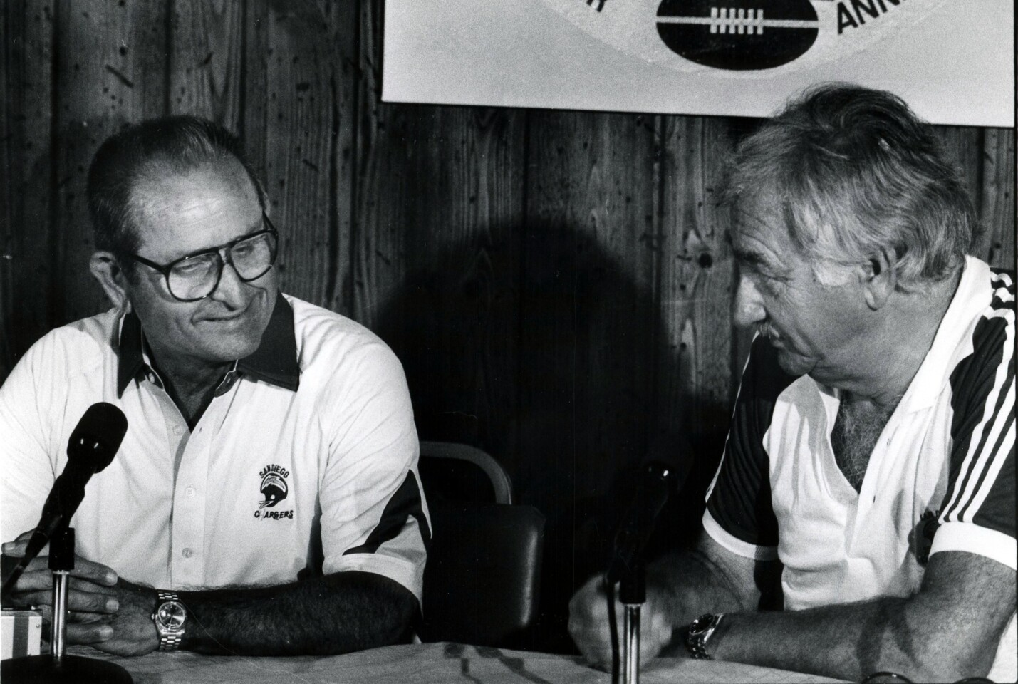New Chargers owner Alex Spanos (left) meets the sporting press with former owner Gene Klein in the dining hall of the team's UCSD training compound on Aug. 2, 1984. Peter Koleman