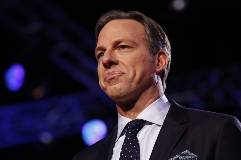 Jake Tapper moderates a Republican primary debate hosted by CNN in 2016.