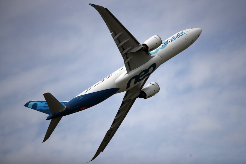 FILE - In this June 18, 2019 file photo, an Airbus A330 performs a demonstration flight at Paris Air Show, in Le Bourget, north east of Paris. France's government has announced 15 billion euros ($16.9 billion) in aid for the virus-battered aerospace industry, including plane maker Airbus and national airline Air France. (AP Photo/ Francois Mori, File)