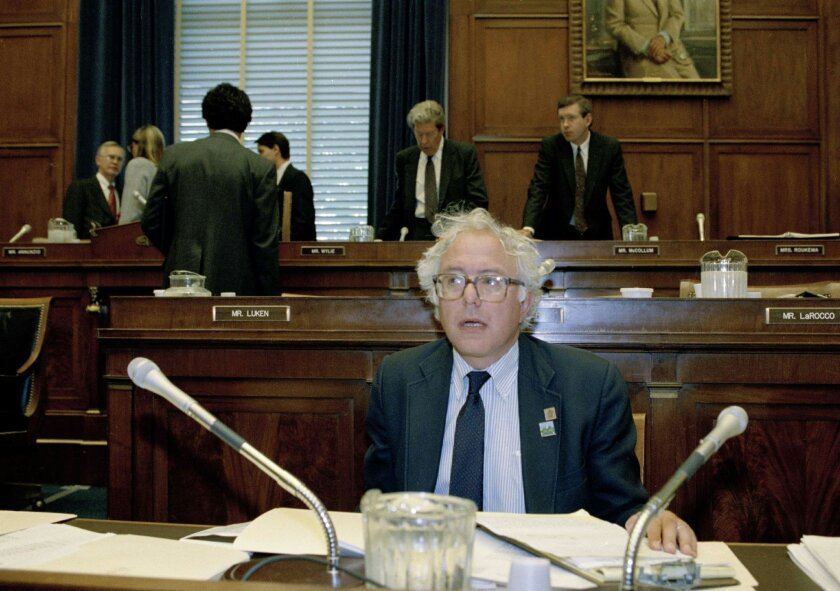 FILE - In this Aug. 11, 1991 file photo, Rep. Bernard Sanders, I-Vt. is seen on Capitol Hill in Washington in the House Banking Committee room. Sanders is the first member of the House in more than 50 years not to be affiliated with either the Republican or Democratic caucuses. Once a democratic socialist, always a democratic socialist. Once a scold of big money in politics, still a scold. No one can accuse Sanders of flip-flopping over his four decades in public life. Rock steady, he's inhabited the same ideological corner from which he now takes on Hillary Rodham Clinton in an improbable quest for the Democratic presidential nomination. (AP Photo/John Duricka, File)