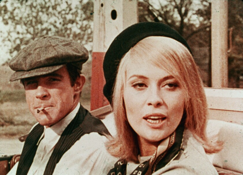 """Warren Beatty and Faye Dunaway sit in a car in """"Bonnie And Clyde"""" (1967)."""