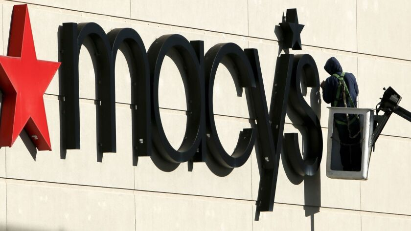 Macy's raised its annual profit forecast as the department store reported an unexpected increase in a key sales figure.