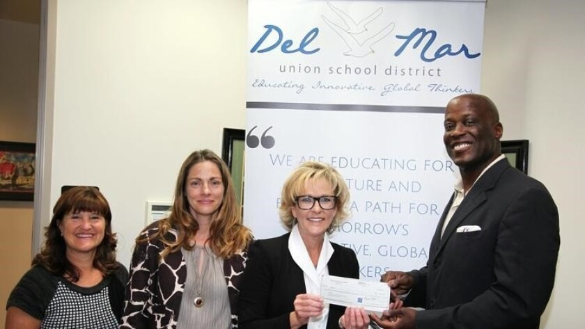 A previous year's Del Mar Schools Education Foundation check presentation to the Del Mar Union School District. (Far right) Del Mar Schools Education Foundation President Ty Humes.