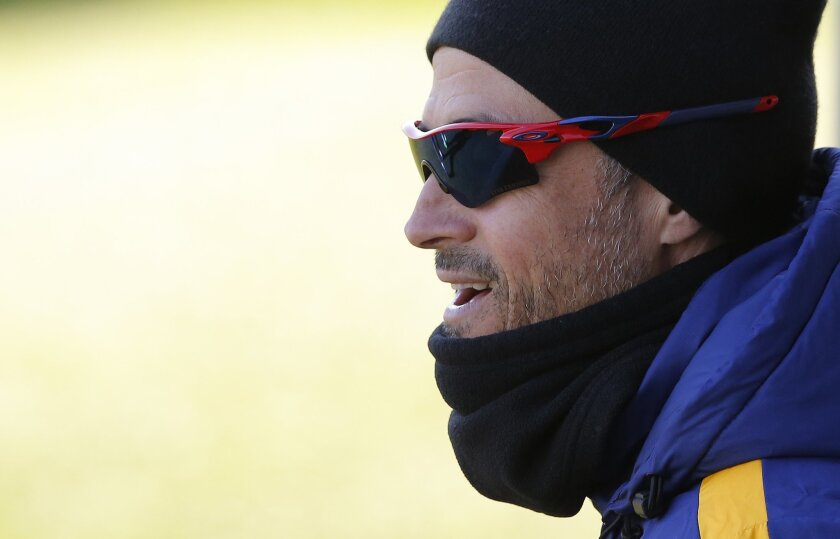 FC Barcelona's head coach Luis Enrique arrives for a training session at the Sports Center FC Barcelona Joan Gamper in San Joan Despi, Spain, Tuesday, Feb. 16, 2016. (AP Photo/Manu Fernandez)