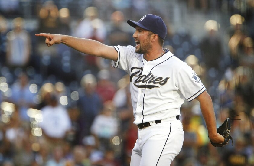 The Padres' closing pitcher Huston Street yells for the third strike call and gets it for the final out giving the Padres the 3-2 win over the Pirates at Petco Park.