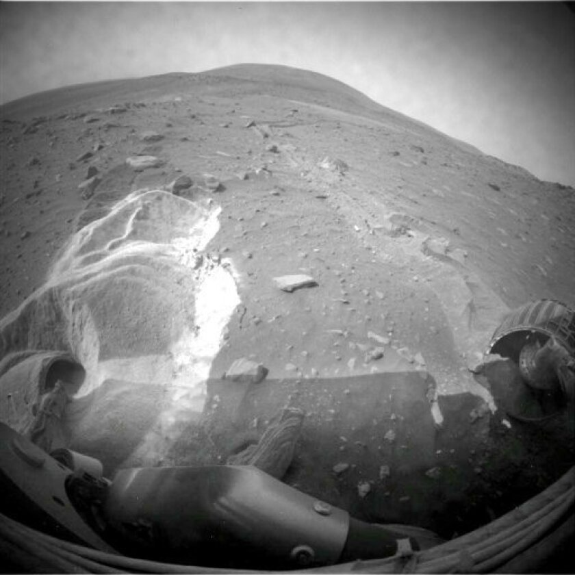 FILE - This undated file image provided by NASA shows the surface of Mars as seen from the stuck Mars rover, Spirit. Spirit has always been the unluckier of NASA's twin Mars rovers. Soon after landing in 2004, its computer went haywire, transmitting gibberish or sporadic data to Earth. Engineers eventually nursed it back to health. As Spirit and Opportunity approach their sixth year of exploration, Spirit finds itself stuck in a Martian sand trap. The robot geologist has been in jams before, but this is by far the toughest challenge it has faced. (AP Photo/NASA, File)