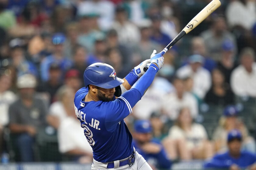 Toronto Blue Jays' Lourdes Gurriel Jr. singles in a pair of runs against the Seattle Mariners during the fourth inning of a baseball game Friday, Aug. 13, 2021, in Seattle. (AP Photo/Elaine Thompson)