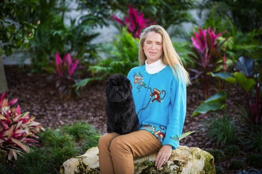 Shannon Biszantz with Tamarin True Grit, aka Dillon, who competed at Westminster. Photo by Jeffrey Hanlin