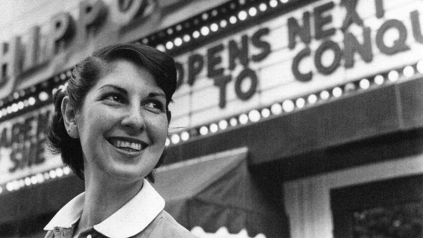 Arena Stage founder Zelda Finchandler, photographed in 1950 in front of the company's first theater venue, the Hippodrome.