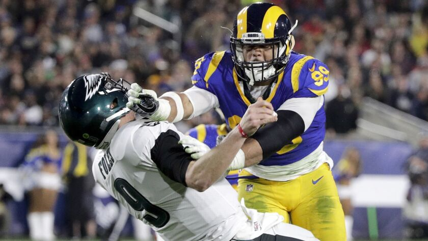 FILE - In this Dec. 16, 2018, file photo, Los Angeles Rams defensive end Aaron Donald hits Philadelp