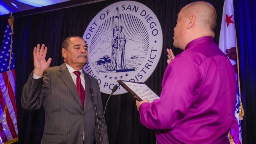 """Port Chairman Robert """"Dukie"""" Valderrama takes the oath of office for his fourth term as a port commissioner from his son Randy."""