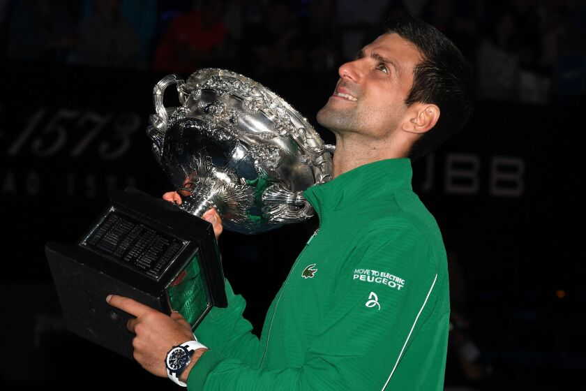 Novak Djokovic holds the Norman Brooks Challenge Cup trophy after beating Dominic Thiem in their men's singles final match at the Australian Open in Melbourne, Australia on Sunday.