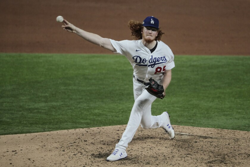 Dodgers starting pitcher Dustin May delivers against the San Diego Padres.