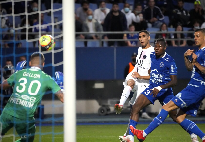 PSG's Achraf Hakimi. center, scores his side's opening goal during the French League One soccer match between Troyes and Paris Saint Germain, at the Stade de l'Aube, in Troyes, France, Saturday, Aug. 7, 2021. (AP Photo/Francois Mori)