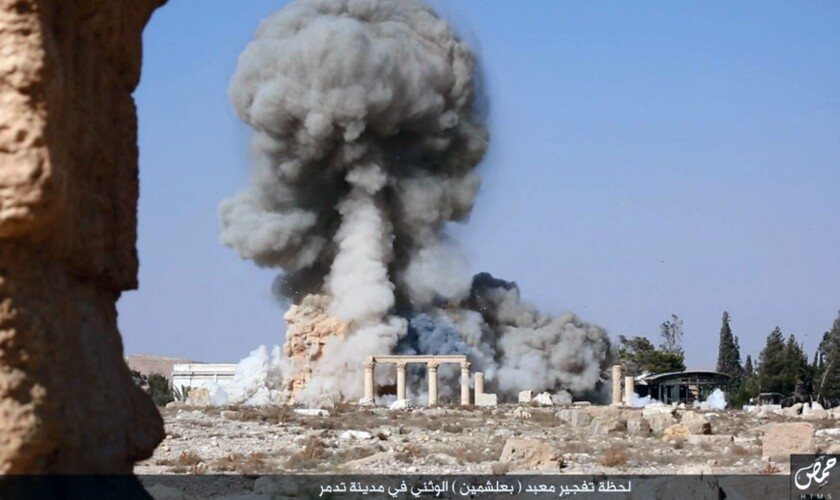 A photo released Aug. 25 on a social media site used by Islamic State militants shows smoke from the detonation of the Temple of Baalshamin in Palmyra, Syria. This image has been verified and is consistent with Associated Press reporting.