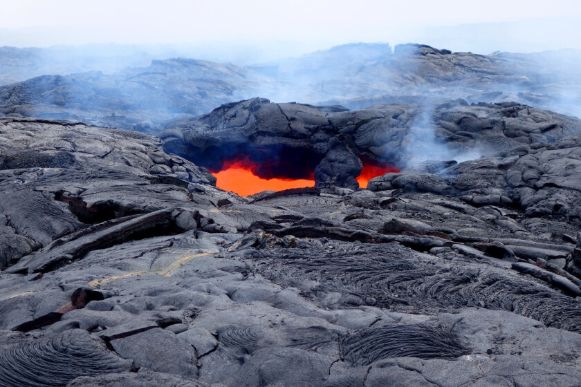 Hot lava glows from a surface vent.