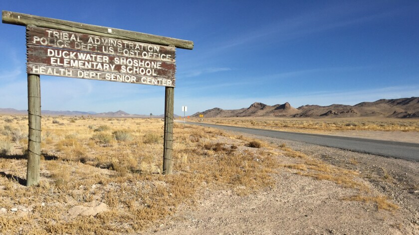 A sign off Highway 379 marks the entrance to Duckwater, Nev. The residents of the Duckwater Shoshone reservation have the longest trek to cast ballots in Nevada, about 270 miles round trip.