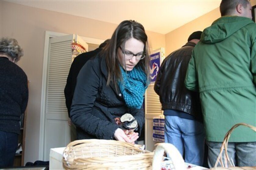 Tiffany Rolfing looks at George McGovern campaign buttons during a two-day estate sale at former U.S. Sen. George McGovern's home in Sioux Falls, S.D. McGovern, a three-time presidential hopeful, died in October at age 90. Now many of his possessions are up for sale at his home in Sioux Falls. (AP