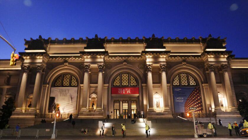 A nighttime view of the Metropolitan Museum of Art.