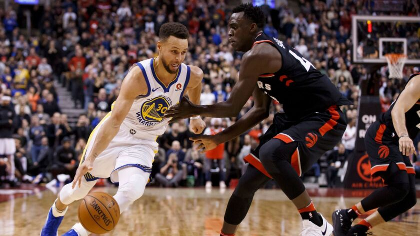 Golden State Warriors guard Stephen Curry drives to the basket against Toronto Raptors forward Pascal Siakam during the second half.