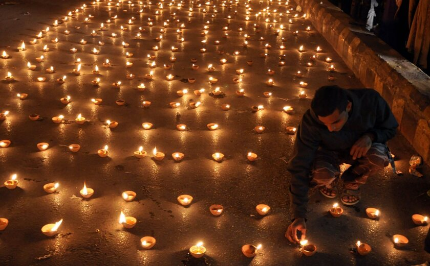 Candles are lighted in Karachi at a memorial ceremony for the children and staffers who were killed in an attack at the army-run school in Peshawar, Pakistan.
