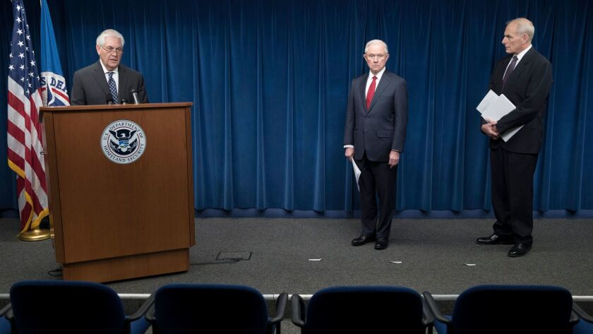 Atty. Gen. Jeff Sessions and Secretary of Homeland Security John F. Kelly listen to Secretary of State Rex Tillerson discuss President Trump's executive order restricting travel from six majority-Muslim countries.