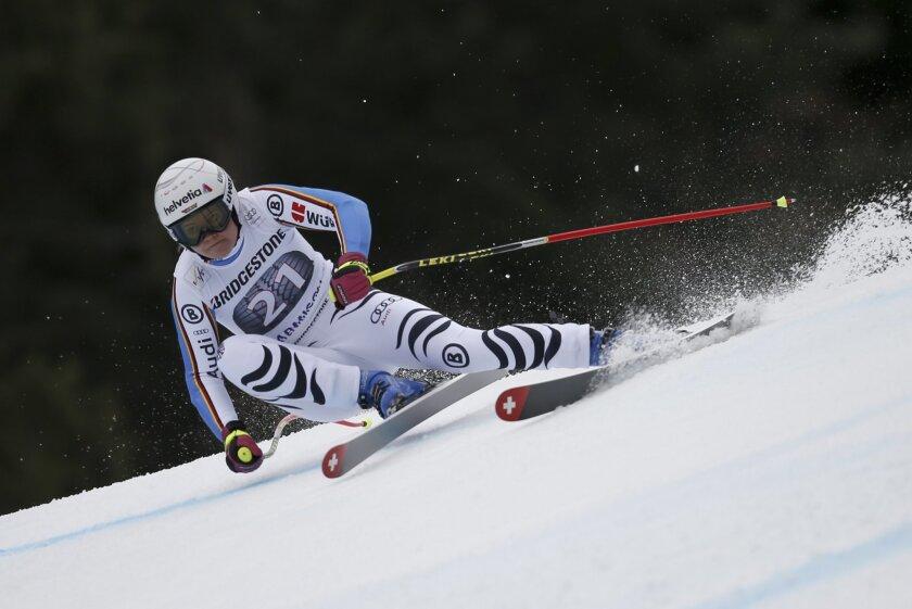 Germany's Viktoria Rebensburg speeds down the course during an Alpine Ski women's World Cup Super G race, in Garmisch Partenkirchen, Germany, Sunday, Feb. 7, 2016. (AP Photo/Marco Trovati)