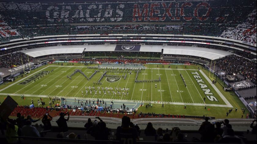"""Performers spell out """"NFL"""" during a halftime presentation of an NFL football game between the Housto"""