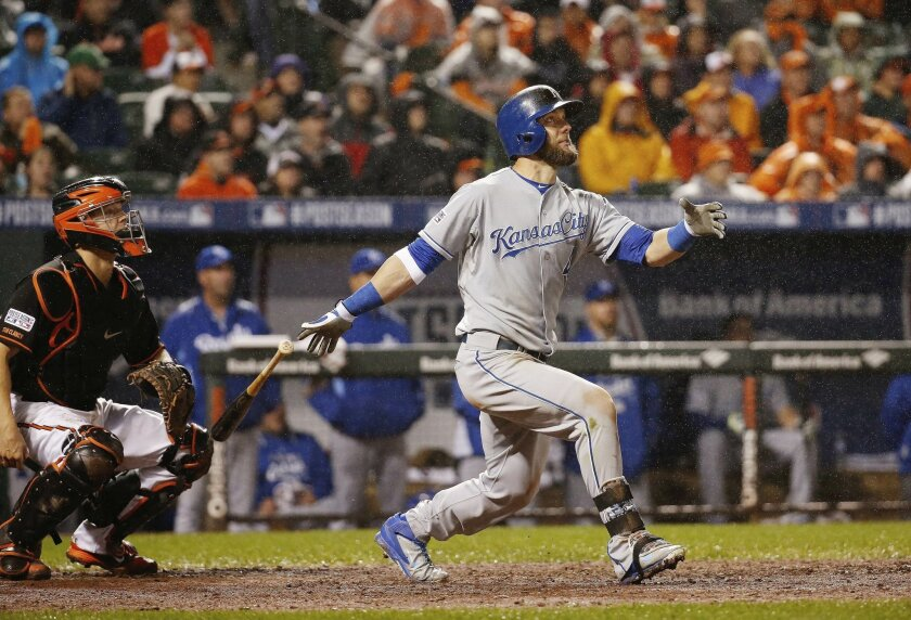 Kansas City Royals' Alex Gordon (4) watches his solo home run during the 10th inning of Game 1 of the American League baseball championship series against the Baltimore Orioles Saturday, Oct. 11, 2014, in Baltimore. (AP Photo/Alex Brandon)