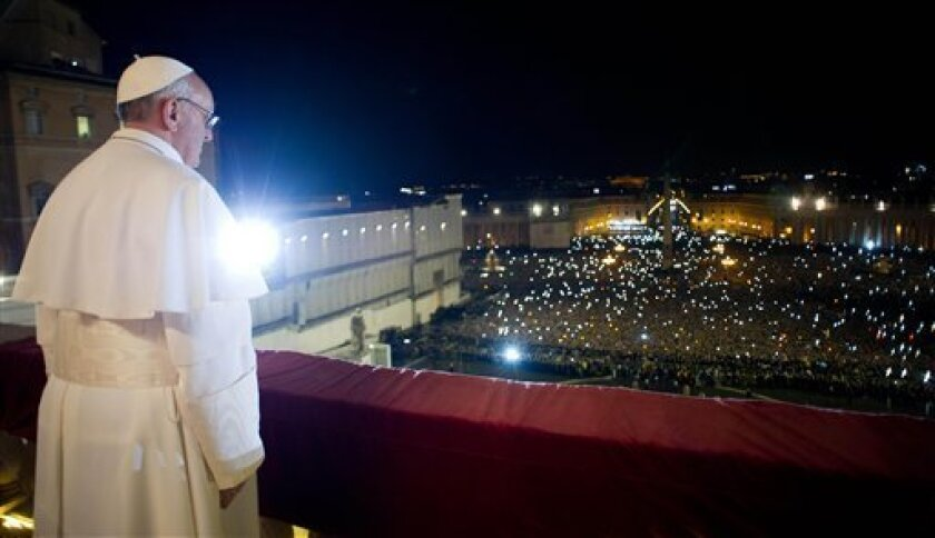 In this photo provided by the Vatican newspaper L'Osservatore Romano, Pope Francis looks at the crowd from the central balcony of St. Peter's Basilica at the Vatican, Wednesday, March 13, 2013. Argentine Cardinal Jorge Mario Bergoglio, who chose the name of Pope Francis, is the 266th pontiff of the Roman Catholic Church. (AP Photo/L'Osservatore Romano, ho)